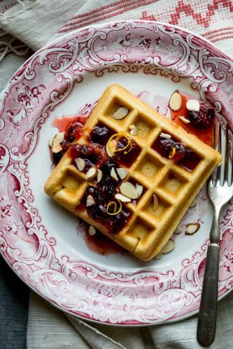 Almond waffles with cranberry orange honey syrup